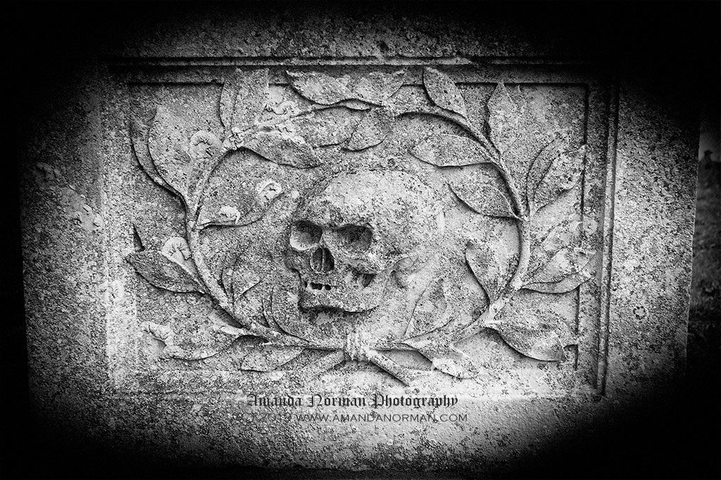 Carved skull on a tomb in Burwell